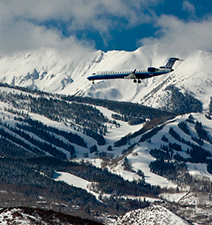 Airplane landing with Snowmass in background